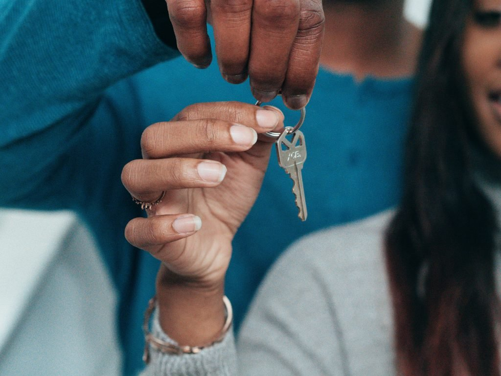 image of two people collecting keys to a new house